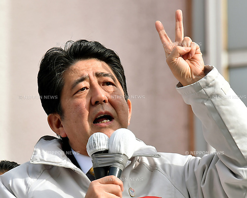 Decem ber 7, 2014, Tokyo, Japan - Japan's Prime Minister Shinzo Abe delivers his message to a huge throng of voters during his stumping stop in the capital's 12th precinct on Sunday, December 7, 2014. Transport Minister Akihiro Ota of Komeito, the ruling coalition ally of the Liberal Democratic Party is running from the precinct. Abe's LDP is expected to retain its dominance in the December 14 parliament's lower house election, according to latest polls. (Photo by Natsuki Sakai/AFLO) AYF -mis-