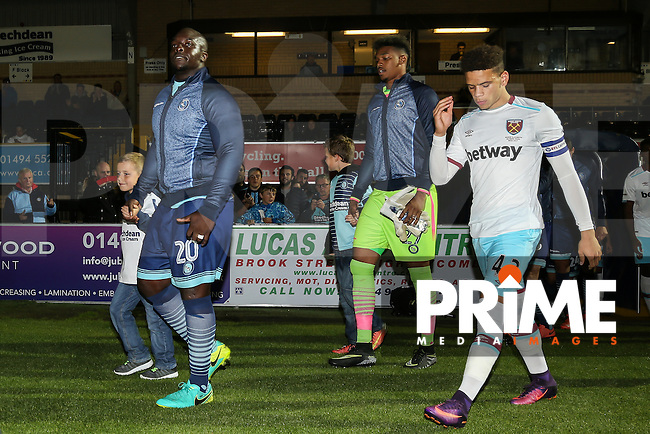 Mascots walk out with the players ahead of the The Checkatrade Trophy match between Wycombe Wanderers and West Ham United U21 at Adams Park, High Wycombe, England on 4 October 2016. Photo by David Horn.
