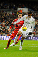 Real Madrid´s Raphael Varane and Sevilla's Vicente Iborra during 2014-15 La Liga match between Real Madrid and Sevilla at Santiago Bernabeu stadium in Alcorcon, Madrid, Spain. February 04, 2015. (ALTERPHOTOS/Luis Fernandez) /NORTEphoto.com