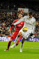 Real Madrid´s Raphael Varane and Sevilla's Vicente Iborra during 2014-15 La Liga match between Real Madrid and Sevilla at Santiago Bernabeu stadium in Alcorcon, Madrid, Spain. February 04, 2015. (ALTERPHOTOS/Luis Fernandez) /NORTEphoto.com
