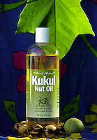 Kukui Nut Oil with leaf from the the state tree, raw nut off the tree and polished nut bracelet