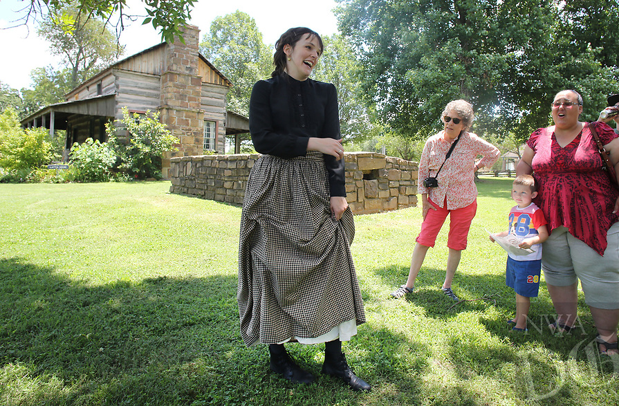 NWA Democrat-Gazette/DAVID GOTTSCHALK   Laura Jennings, park interpreter at Prairie Grove Battlefield State Park, portrays Jane Starr Latta from the 1850's Thursday, July 6, 2017, as she gives a living history tour of the Latta House at Prairie Grove Battlefield State Park. A variety of programs, tours and activities continue through the summer at the park including black powder demonstrations, Ozark folklore, battlefield tours and summer youth day camps.