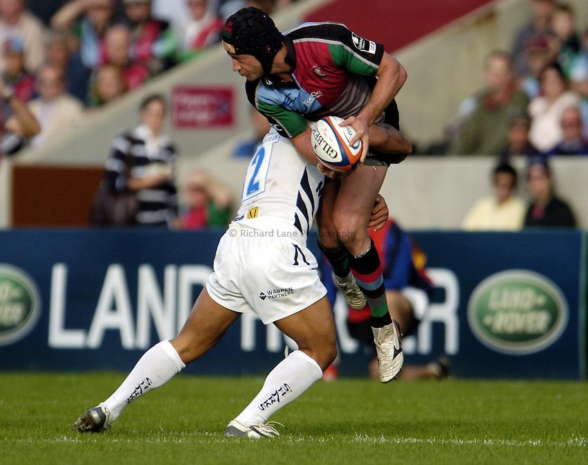 Photo: Olly Greenwood..NEC Harlequins v Sale Sharks. EDF Anglo-Welsh Cup. 07/10/2006. Sale's Elvis Seveali'l tackles Quins Hal Luscombe.