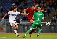 Calcio, Serie A: Roma vs Crotone. Roma, stadio Olimpico, 25 ottobre 2017.<br /> Roma's Edin Dzeko, center, is challenged by Crotone's Stefan Simic, left, and goalkeeper Alex Cordaz, during the Italian Serie A football match between Roma and Crotone at Rome's Olympic stadium, 25 October 2017.<br /> UPDATE IMAGES PRESS/Riccardo De Luca
