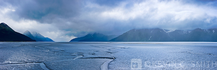 Photo of spring storm clouds over the Turnagain Arm mudflats and mountains, southcentral Alaska, USA.