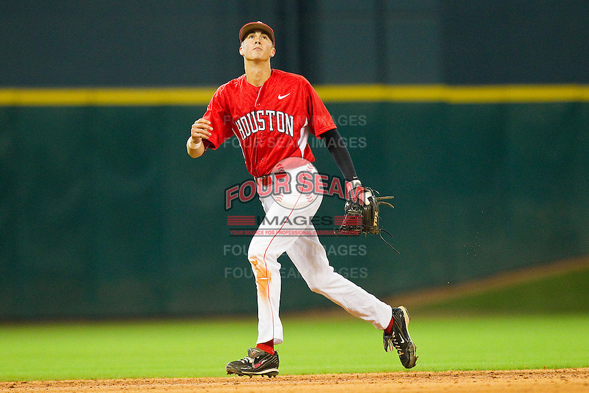 Shortstop Chase Jensen #17 of the Houston Cougars tracks a fly ball against the Kentucky Wildcats at Minute Maid Park on March 5, 2011 in Houston, Texas.  Photo by Brian Westerholt / Four Seam Images