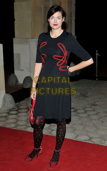 JASMINE GUINNESS .Attending the Tatler 300th anniversary party, in London, England, UK,.October 14, 2009..full length black dress red polka dot tights peep toe ankle strap shoes sleeves .CAP/PL.©Phil Loftus/Capital Pictures.