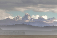 Window on the Grand Tetons through a veil of rain.  An autumn thunderstorm made shooting difficult but I'm glad I put forth the effort. West side of the Grand Tetons from Ashton Idaho