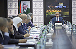 Palestinian Prime Minister Mohammad Ishtayeh charis the weekly meeting of his government, in the West Bank city of Ramallah, on October 7, 2019. Photo by Prime Minister Office