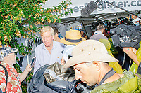 Surrounded by media, former Mass. governor Bill Weld, a Republican presidential candidate, walks through the fair on a rainy day at the Iowa State Fair in Des, Moines, Iowa, on Sun., Aug. 11, 2019.