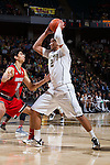 Devin Thomas (2) of the Wake Forest Demon Deacons works down low against Anas Mahmoud (14) of the Louisville Cardinals during first half action at the LJVM Coliseum on January 4, 2015 in Winston-Salem, North Carolina.  The Cardinals defeated the Demon Deacons 85-76.  (Brian Westerholt/Sports On Film)