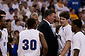 11 February 2012: Greg McDermott head coach of the Creighton Bluejays getting after Doug McDermott #3 for his performance against the Wichita State Shockers at the CenturyLink Center in Omaha, Nebraska.  Wichita State defeated Creighton 89 to 68.