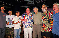 "HONOLULU, Turtle Bay Resort, North Shore, Oahu. - (Thursday, January 3, 2013) Kohl Christensen (HAW), Garrett McNamara (HAW), Reno Abellira (HAW), Greg Noll (HAW), Peter Cole (USA) Kimo Hollinger (HAW) and Randy Rarick (HAW).   Greg Noll (USA) was the guest  speaker of Talk Story at Surfer The Bar tonight, Noll, nicknamed ""Da Bull"" by Phil Edwards in reference to his physique and way of ""charging"" down the face of a wave is an American pioneer of big wave surfing and is also acknowledged as a prominent longboard shaper. Noll was a member of a US lifeguard team that introduced Malibu boards to Australia around the time of the Melbourne Olympic Games. Noll became known for his exploits in large Hawaiian surf on the North Shore of Oahu. He first gained a reputation in November 1957 after surfing Waimea Bay in 25-30 ft surf when it had previously been thought impossible even to the local Hawaiians. He is perhaps best known for being the first surfer to ride a wave breaking on the outside reef at the so-called Banzai Pipeline in November 1964...It was later at Makaha, in December 1969, that he rode what many at the time believed to be the largest wave ever surfed. After that wave and the ensuing wipeout during the course of that spectacular ride down the face of a massive dark wall of water, his surfing tapered off and he closed his Hermosa Beach shop in the early 1970s. He and other surfers such as Pat Curren, Mike Stang, Buzzy Trent, George Downing, Mickey Munoz, Wally Froyseth, Fred Van Dyke and Peter Cole are viewed as the most daring surfers of their generation...Noll is readily identified in film footage while surfing by his now iconic black and white horizontally striped ""jailhouse"" boardshorts and was interviewed by host Jodi Wilmott (AUS). . Photo: joliphotos.com"