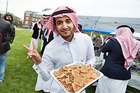 Mississippi State University chemistry doctoral student Mohammed N. Almtiri offers a friendly smile and pancakes from the Saudi Student Association booth during the university's 28th annual International Fiesta. Sponsored by World Neighbors Association and MSU&rsquo;s Holmes Cultural Diversity Center, the popular event provides domestic and international students an opportunity to share food, music, dance and other aspects of various cultures with the campus and local communities. <br />