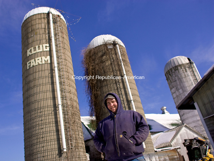 TORRINGTON, CT-05 FEBRUARY 2009-020509BF03-- Harry Klug, owner of Klug Farm, along with his father Butch, stands in front of feed silos that are filled  with food for the 90 milking cows at the farm in Torrington. Higher costs overall and shrinking profits per gallon on milk is taking a toll on Connecticut's remaining dairy farmers.<br />  Bob Falcetti Republican-American