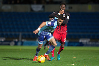 Paris Cowan-Hall of Wycombe Wanderers holds off Gaël Bigirimana of Coventry City during the The Checkatrade Trophy Southern Group D match between Wycombe Wanderers and Coventry City at Adams Park, High Wycombe, England on 9 November 2016. Photo by Andy Rowland.