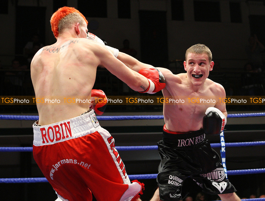 Ryan Walsh (Cromer, black shorts) defeats Robin Deakin (Crawley, red shorts) in a Featherweight boxing contest at York Hall, Bethnal Green, promoted by Frank Warren, Sports Network - 26/09/08 - MANDATORY CREDIT: Gavin Ellis/TGSPHOTO - Self billing applies where appropriate - 0845 094 6026 - contact@tgsphoto.co.uk - NO UNPAID USE.