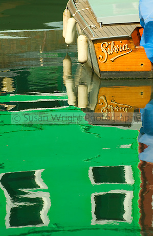 Colours refelcted in the waterways of Burano Island, Venice, Italy