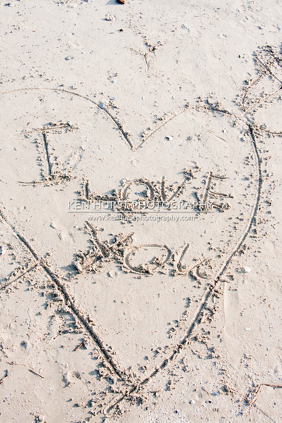 """I Love You"" written in a heart in the sand on Holly Beach near Cameron, Louisiana on the Gulf Of Mexico."