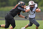 Wescliin's Alex Peterson grabs Dupo running back Lucas Rea. Wesclin defeated Dupo 34-30 on Saturday August 31, 2019 in a game that was stopped Friday night at halftime due to storms. <br /> Tim Vizer/Special to STLhighschoolsports.com