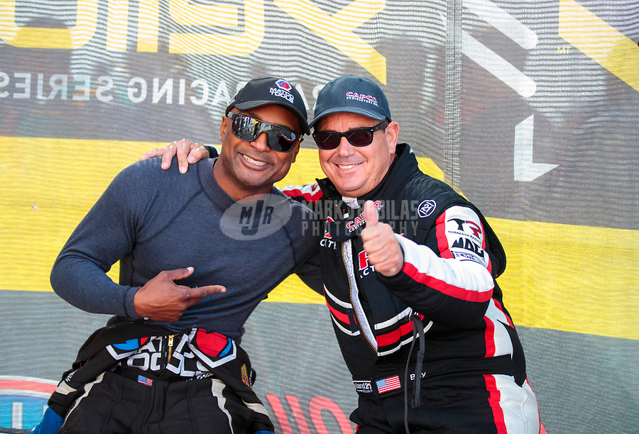 Aug 18, 2019; Brainerd, MN, USA; NHRA top fuel driver Antron Brown (left) and Billy Torrence during the Lucas Oil Nationals at Brainerd International Raceway. Mandatory Credit: Mark J. Rebilas-USA TODAY Sports