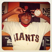 SAN FRANCISCO, CA - JULY 1: Instagram of Cincinnati Reds manager Dusty Baker's son Darren Baker getting ready to throw out the first pitch before the game against the San Francisco Giants at AT&T Park on July 1, 2012 in San Francisco, California. (Photo by Brad Mangin)