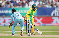 Adil Rashid (England) looks to collect as Alex Carey (Australia) scrambles for ground during Australia vs England, ICC World Cup Semi-Final Cricket at Edgbaston Stadium on 11th July 2019