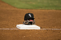 An AZL White Sox hat rests on a glove on third base during an Arizona League game against the AZL Dodgers at Camelback Ranch on July 7, 2018 in Glendale, Arizona. The AZL Dodgers defeated the AZL White Sox by a score of 10-5. (Zachary Lucy/Four Seam Images)