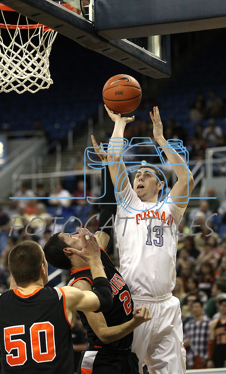 Gorman's Ben Carter shoots over Douglas defenders James Herrick and Nathan VonAhsen during a semi-final game in the NIAA 4A State Basketball Championships between Bishop Gorman and Douglas high schools at Lawlor Events Center in Reno, Nev, on Thursday, Feb. 23, 2012. .Photo by Cathleen Allison