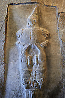 The Sword God from the Sancutary of Yazilikaza, Hattusha, Turkey. Probably the weirdest representation of the rock sanctuary Yazilikaza, shows a sword God. He is waering a high pointed cap, whose ornamented with horns showing he is a divine character. The lower part of his body is formed of two hanging lions that merge into a sword blade . The body of God seems to form the sword handle and the sword being stuck into the ground could indicate that there is a god of the underworld. Cast from the original. Vorderasiatisches Museum, Pergamon Museum, Berlin