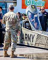 Mar 16, 2018; Gainesville, FL, USA; NHRA top fuel driver Tony Schumacher points at a US Army soldier during qualifying for the Gatornationals at Gainesville Raceway. Mandatory Credit: Mark J. Rebilas-USA TODAY Sports