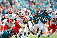November 08, 2009:     Kansas City Chiefs running back Jamaal Charles (25) tries to break the tackle of Jacksonville Jaguars running back Montell Owens (24 )during first half action between the AFC West  Kansas City Chiefs and AFC South Jacksonville Jaguars at Jacksonville Municipal Stadium in Jacksonville, Florida............