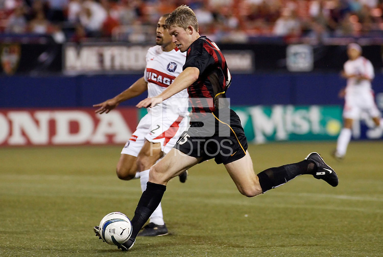 The MetroStars' John Wolyniec beats Chicago's C.J. Brown and scores the game winning goal in the 57th minute. The Chicago Fire were defeated by the NY/NJ MetroStars 2-1 at Giant's Stadium, East Rutherford, NJ, on July 24, 2004.