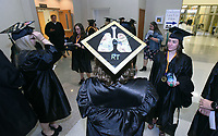 NWA Democrat-Gazette/FLIP PUTTHOFF <br /> CONGRATULATIONS NWACC GRADS<br /> Courtney Voigt, who received a degree in respiratory therapy,  sports artwork of lungs on her mortarboard Saturday May 11 at the 29th annual Northwest Arkansas Community Collegee commencement. Four commencements were held at 10 a.m., noon, 2 p.m. and 4 p.m. at Arend Arts Center on the Bentonville High School campus.