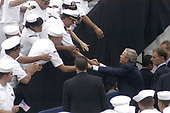 Coronado, Calif. (Aug. 30, 2005) - President George W. Bush pauses to greet and shake hands with San Diego-area Sailors after delivering a speech commemorating the 60th anniversary of the allied victory over Japan (V-J Day) during World War II. The ceremony was held on board Naval Air Station North Island. <br /> Mandatory Credit: Gregory S. Cleghorne / US Navy via CNP