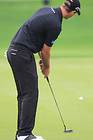 Nicolas Colsaerts (BEL) putts on the 14th green during Friday's Round 2 of the 2014 BMW Masters held at Lake Malaren, Shanghai, China 31st October 2014.<br /> Picture: Eoin Clarke www.golffile.ie