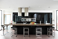 There is ample room for six at the long Quartz stone floating island of the kitchen/living area