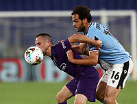 Football, Serie A: S.S. Lazio - Fiorentina, Olympic stadium, Rome, June 27, 2020. <br /> Fiorentina's Frank-Henry Ribéry (l) in action with Lazio's captain Marco Parolo (r) during the Italian Serie A football match between S.S. Lazio and Fiorentina at Rome's Olympic stadium, Rome, on June 27, 2020. <br /> UPDATE IMAGES PRESS/Isabella Bonotto