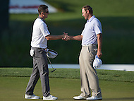 Bethesda, MD - June 29, 2014: Justin Rose (l) shakes Shawn Stefani's hand after winning the Quicken Loans National playoff at the Congressional Country Club in Bethesda, MD, June, 29, 2014.   (Photo by Don Baxter/Media Images International)