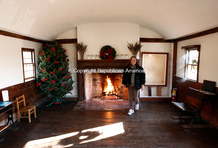 Roxbury, CT- 27 December 2013-122813CM09-  COUNTRY LIFE ONLY PLEASE--- Mary Daniel, with the board of directors for the Roxbury Land Trust stays warm inside the Good Hill School house during an open house in Roxbury on Saturday afternoon.    Christopher Massa Republican-American