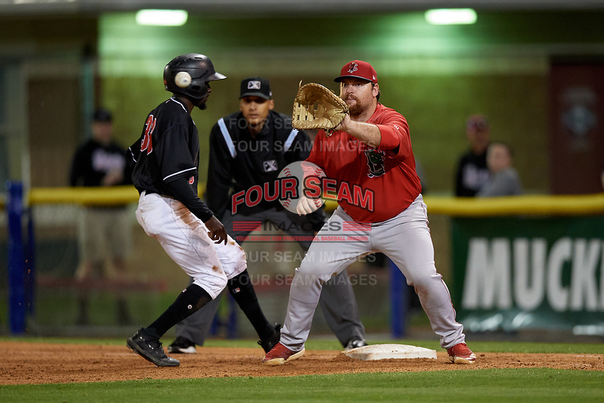 Lowell Spinners first baseman Joe Davis (55) waits for a pickoff attempt throw as Milton Smith II gets back to the bag with umpire Jon-Tyler Shaw looking on during a NY-Penn League Semifinal Playoff game against the Batavia Muckdogs on September 4, 2019 at Dwyer Stadium in Batavia, New York.  Batavia defeated Lowell 4-1.  (Mike Janes/Four Seam Images)
