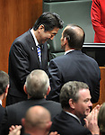 AUSTRALIA, Canberra : Japanese Prime Minister Shinzo Abe is congratulated by Australian Prime Minister Tony Abbott after addressing the  Parliament House in Canberra on July 8, 2014. Defence ties are set to take centre stage when Australia plays host to Japanese Prime Minister Shinzo Abe this week, as the two countries look set to strengthen their relationship through annual leaders' meetings. AFP PHOTO / Mark GRAHAM