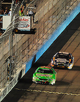 Apr 11, 2008; Avondale, AZ, USA; NASCAR Nationwide Series driver Kyle Busch (18) takes the checkered flag ahead of Carl Edwards (60) to win the Bashas Supermarkets 200 at the Phoenix International Raceway. Mandatory Credit: Mark J. Rebilas-