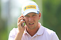 Marcel Siem (GER) on the phone during practice ahead of Abu Dhabi HSBC Golf Championship played at Abu Dhabi Golf Club 16-19 January 2014.(Picture Credit / Phil Inglis)