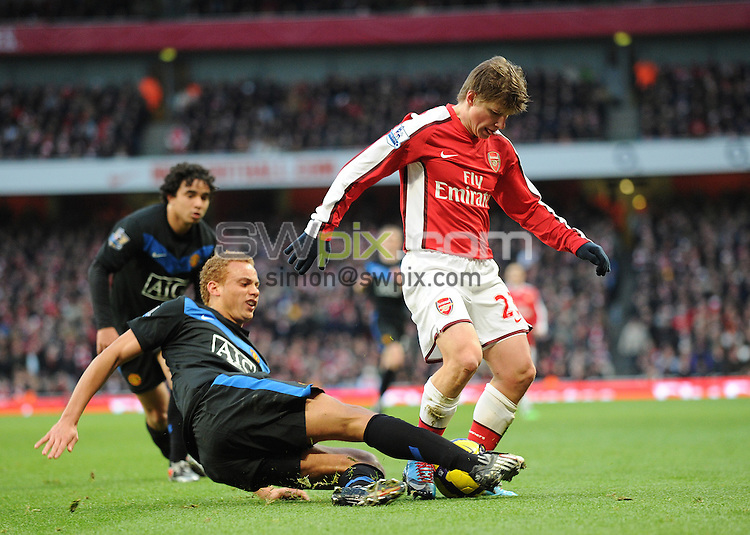 PICTURE BY JEREMY RATA/SWPIX.COM. Barclays Premier league 2009/10 - Arsenal v Manchester United- Emirates Stadium, London, England. 31st January 2010. Arsenal's Andrey Arshavin is tackled by  Man Utd's Wes Brown..Copyright - Simon Wilkinson - 07811267706