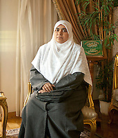 Salwa Abdel Wahab, 39 years old, is a human development trainer; she has two children. Salwa has been engaged in the Muslim Brotherhood organisation for twenty years. Here she poses in Amal Abdel El-Karim's apartment in Doqqi district - Amal is in charge of the women section of FJP in Giza. Cairo, Egypt. October 2012.<br /> (assignment for the Financial Times)