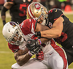 San Francisco 49ers linebacker Nick Bellore (50) tackles Arizona Cardinals running back David Johnson (31) on Thursday, October 06, 2016 at Levis Stadium in Santa Clara, California. The Cardinals defeated the 49ers 33-21.