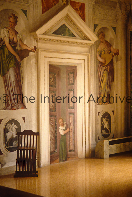 A jokey trompe l'oeil door forms part of the decorative scheme of murals in the grand entrance hall of the Villa di Maser by Palladio