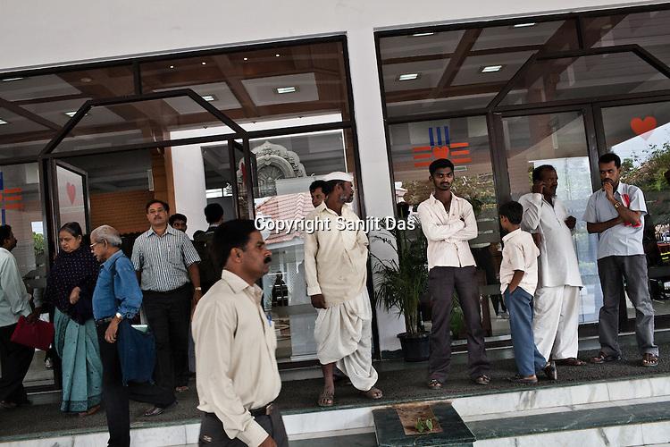 Family members seen outside the Narayana Hrudayalaya in Bangalore, Karnataka, India. Photo: Sanjit Das/Panos