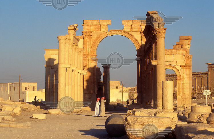 Triumphal arch in the ancient ruins of Palmyra. Palmyra (or Tadmor in Arabic) dates back to the Neolithic period and was first mentioned in the second millennium BC as a caravan stop. It later came under the Seleucid Empire and then under the Roman Empire.<br /> In May 2015 Islamic State (IS) forces fighting the Syrian government of President Assad took control of the modern settlement of Tadmur and the historic site. There are fears that the priceless treasures could fall victim to IS's iconoclastic destruction that has seen museums and ancient sites across Syria and Iraq destroyed.
